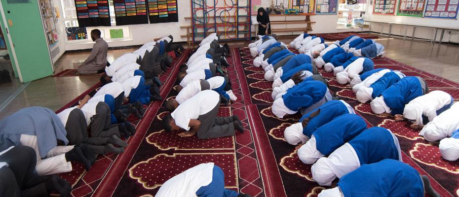 Prayers in the main school hall.