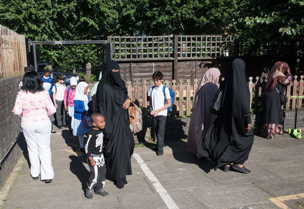 Children arriving at school at the beginning of the day.