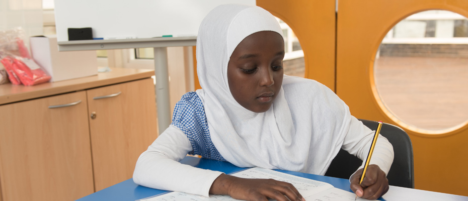 Girl working hard and concentrating during and Arabic Studies lesson.