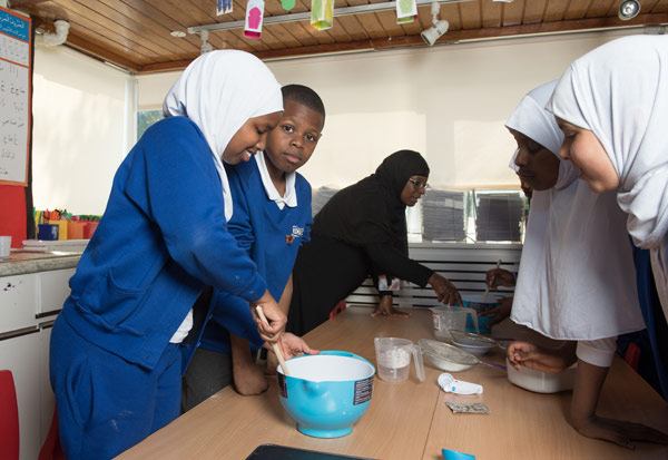 Preparing the dough for bread making in a DT lesson.