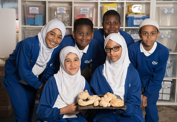 Students proud of their bread made during a DT lesson.
