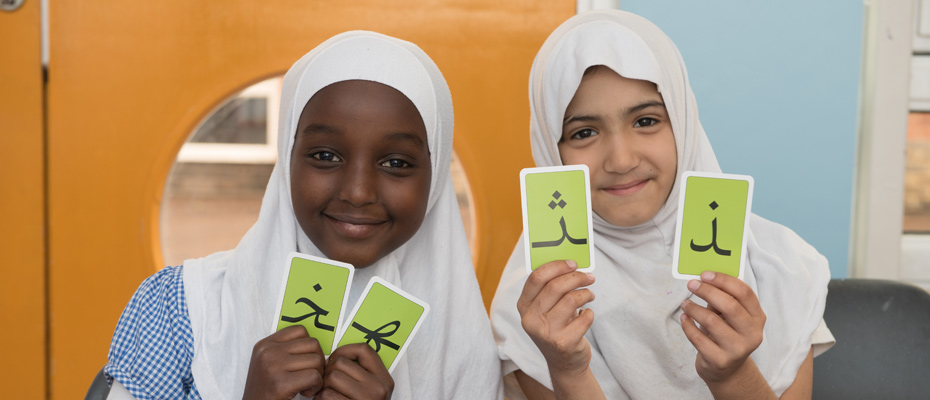 Students using flash cards during an Islamic lesson.