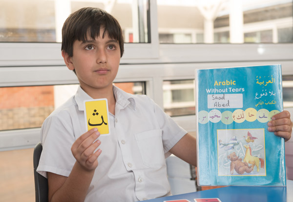 Learning Arabic text during an Islamic lesson.
