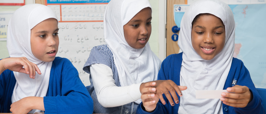 Children debating a topic during a class lesson.