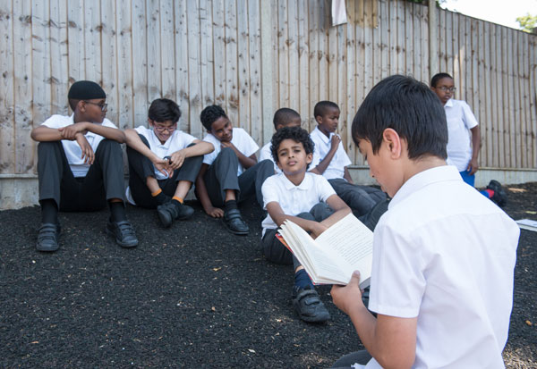Group of boys discussing a topic in the playground.