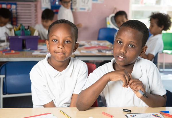 Two boys concentrating on their work during an English lesson.