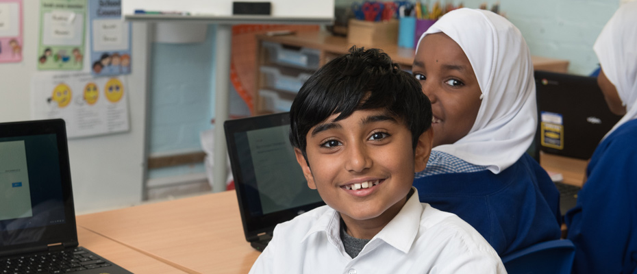 Students enjoying their computing lesson.