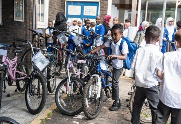 Students trying out the vast selection of affordable bikes.
