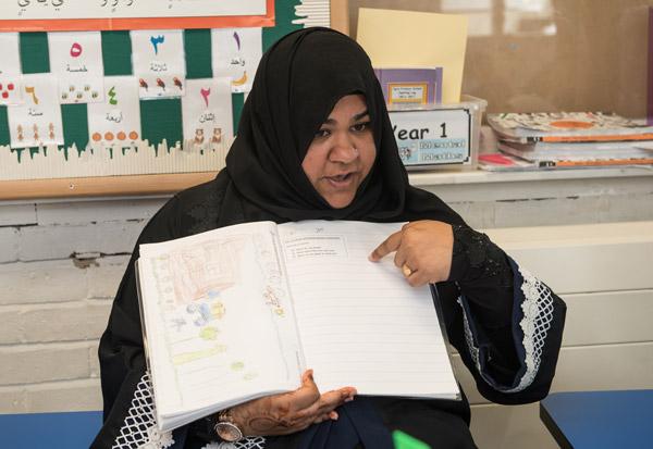 Teacher explaining a story during an English lesson.